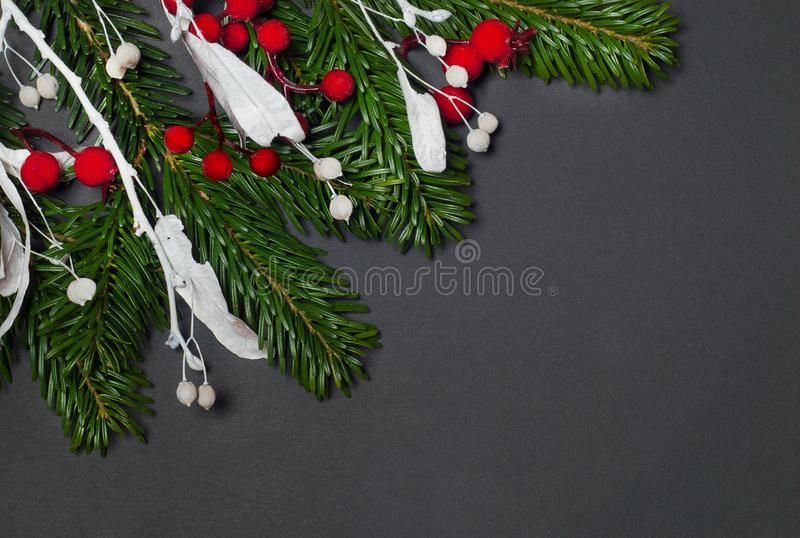 Elegant christmas background on black paper. Top view stock photography