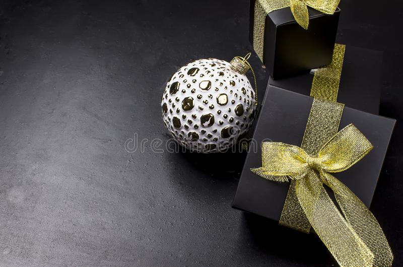 Elegant Christmas background with white retro balls and gifts stock photo