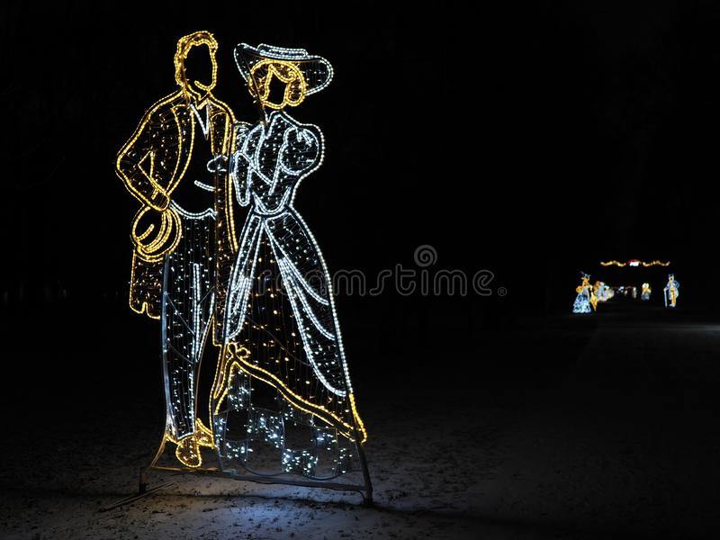 Elegant christmas decorations on main alley at lazienki baths park in european city of Warsaw in Poland at night. Elegant christmas decorations on main alley at royalty free stock photo