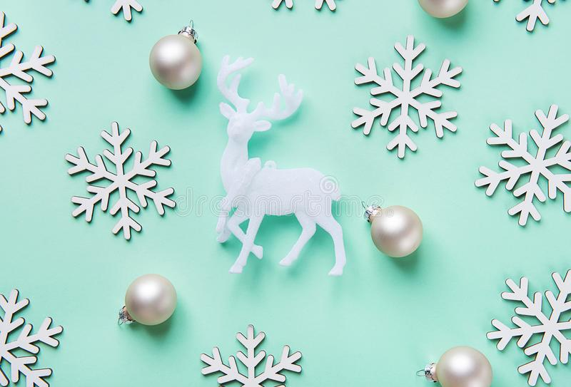Elegant Christmas New Year Greeting Card Poster White Reindeer Snow Flakes Balls Pattern on Turquoise Blue Background. royalty free stock photos