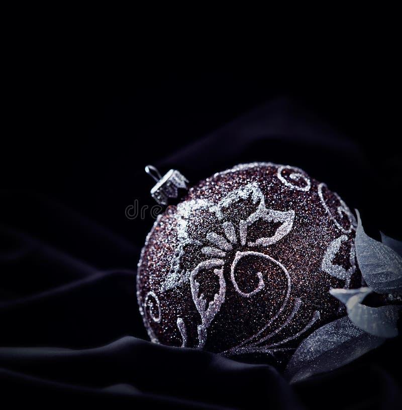 Elegant christmas ornament on dark velvet stock photography