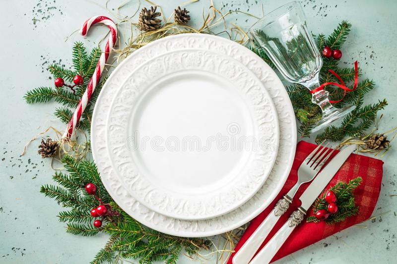 Elegant christmas table setting design top view, flat lay. Elegant christmas table setting design captured from above top view, flat lay. Empty white plate stock images