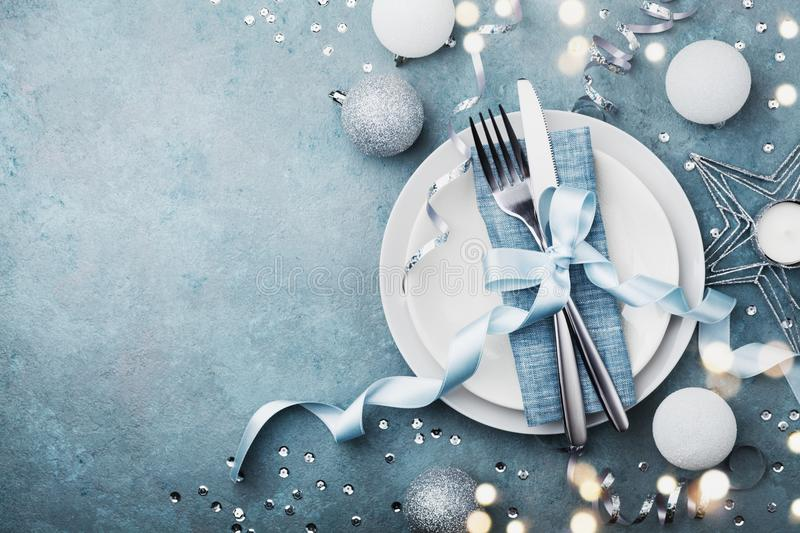 Elegant christmas table setting for holiday dinner top view. Empty space for text. Bokeh effect. royalty free stock images