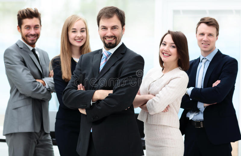 Elegant co-workers looking at camera during meeting in office royalty free stock image
