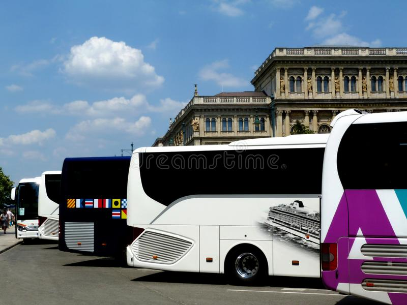 Colorful tour buses parked by the Hungarian Academy of Sciences and beside the Chain bridge stock photo