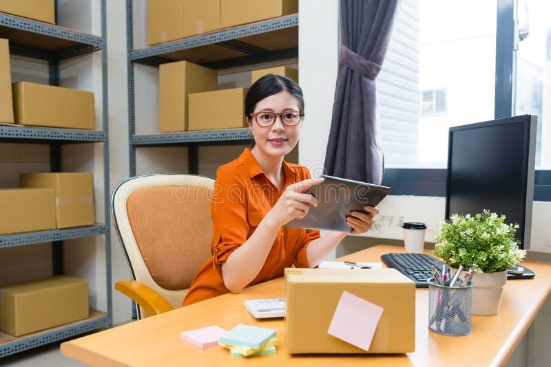 Elegant confident online shopping owner woman stock image