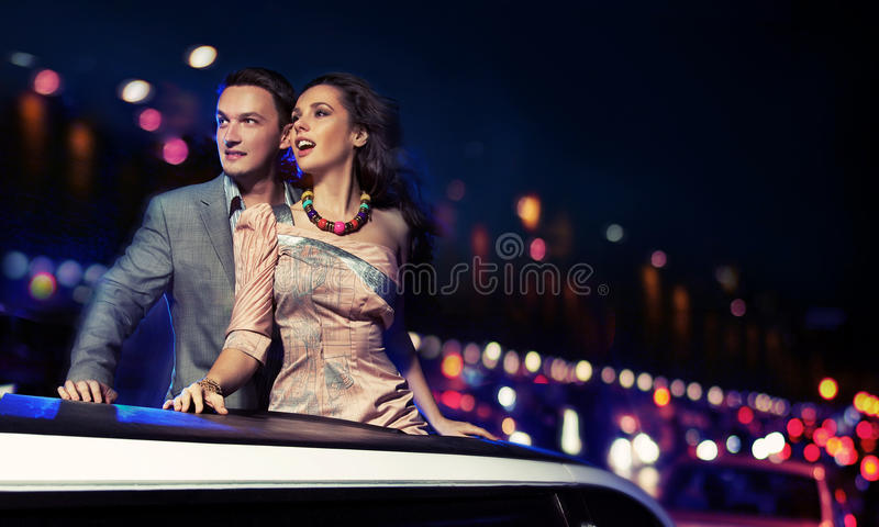 Elegant couple. Traveling a limousine at night