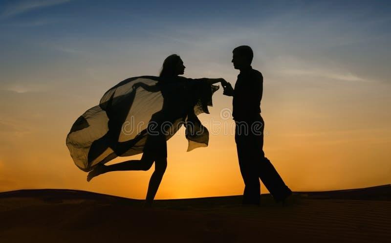 Elegant couple dancing at sunset stock photo