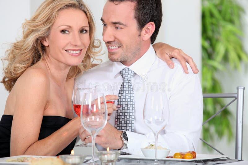 Elegant couple drinking wine royalty free stock photography