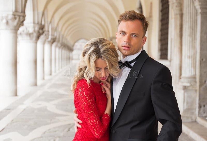 Elegant couple embracing stock images