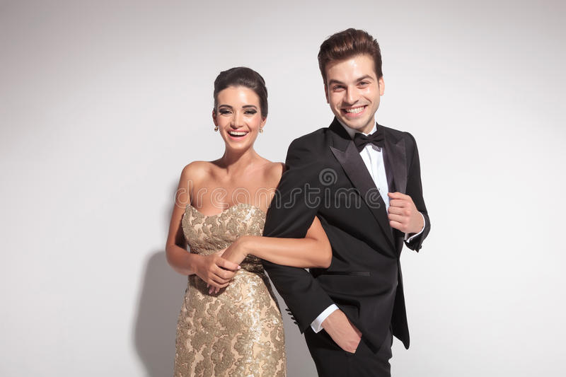 Elegant couple laughing for the camera royalty free stock photos