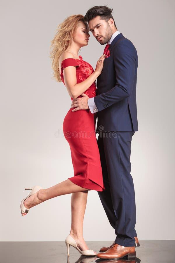 Elegant couple standing face to face stock photos