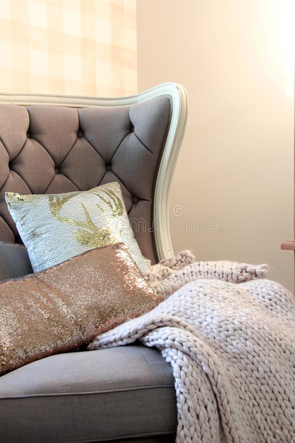 Accent chair with chunky knit blanket royalty free stock image