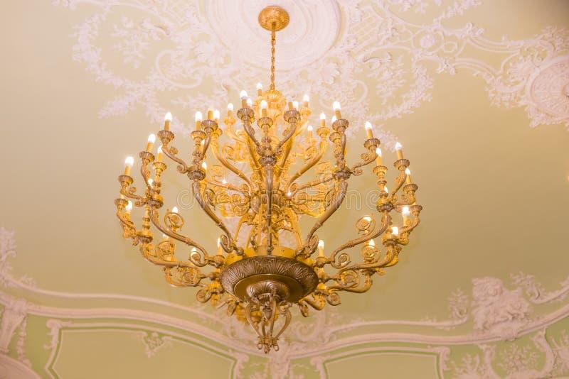Elegant crystal chandelier.vintage pendant chandelier. Large crystal chandelier with pendants in ceiling. Luxurious. Elegant crystal chandelier. Large crystal royalty free stock photo
