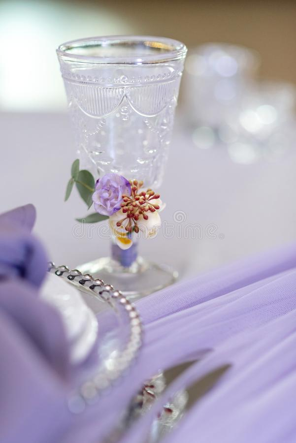 Elegant crystal glass with a stained glass pattern. A wedding glass on a table stock image