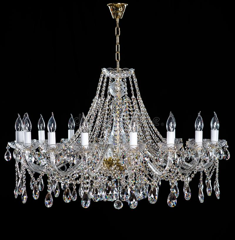 Elegant crystal strassljuskrona med tio lampor royaltyfria foton