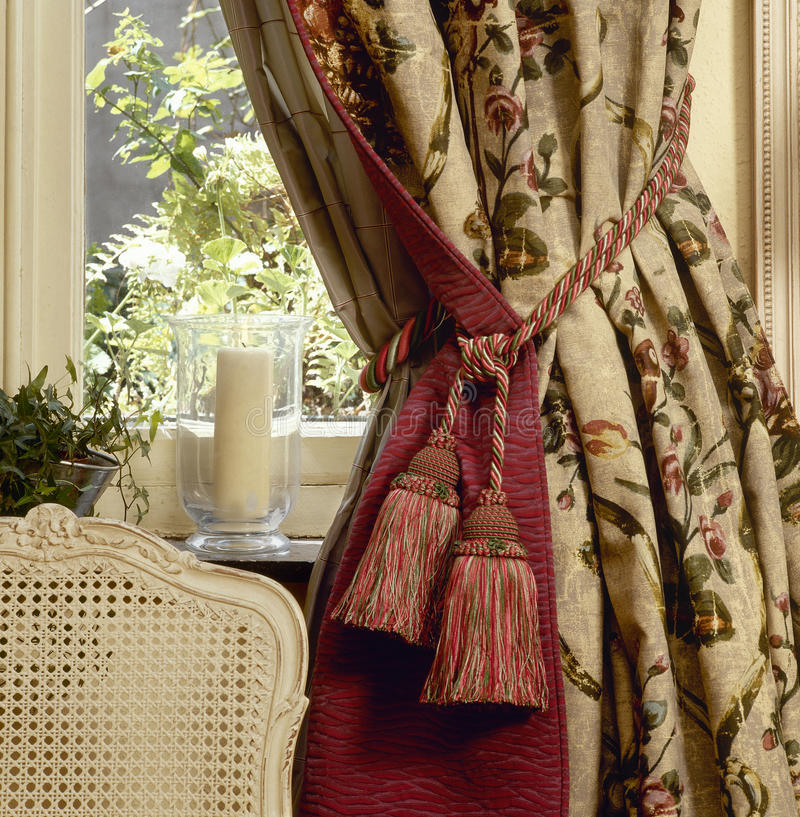Elegant curtain. Chair and window royalty free stock image