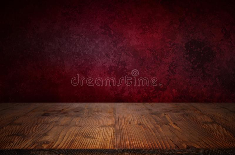 Valentines background with wooden stage. Elegant dark red valentines background in front of a wooden stage royalty free stock photo