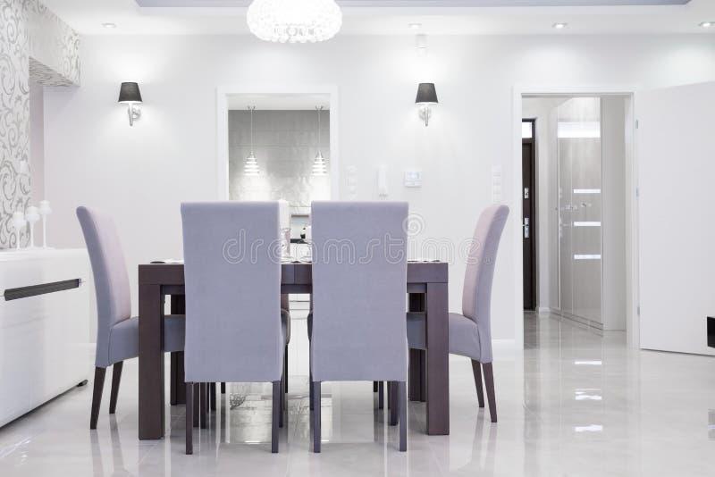 Elegant dining hall. Elegant white dining hall with pretty modern decoration royalty free stock image