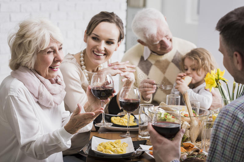 Elegant dinner of a multigenerational family royalty free stock photography