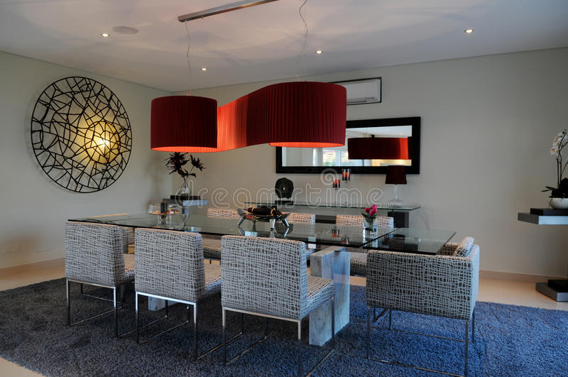 Download Elegant Dinning Space With Red Ceiling Lampshade Stock Photo - Image: 24512252
