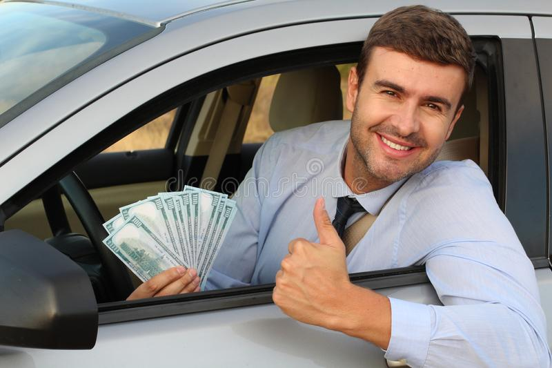 Elegant driver holding lots of dollars royalty free stock images