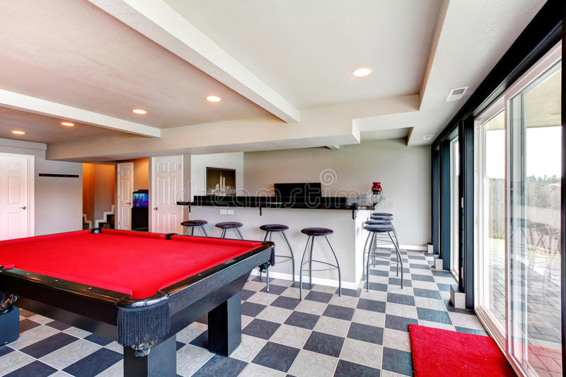 Elegant Entertainment Room With Pool, Bar And Fireplace Stock Photos