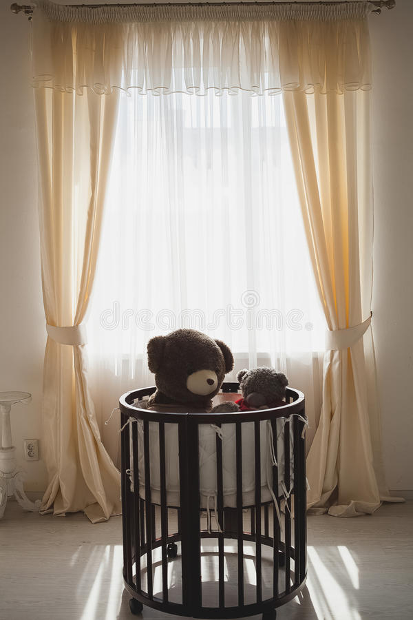 Elegant expensive bed for newborn baby. Luxury decorations of apartments royalty free stock photo