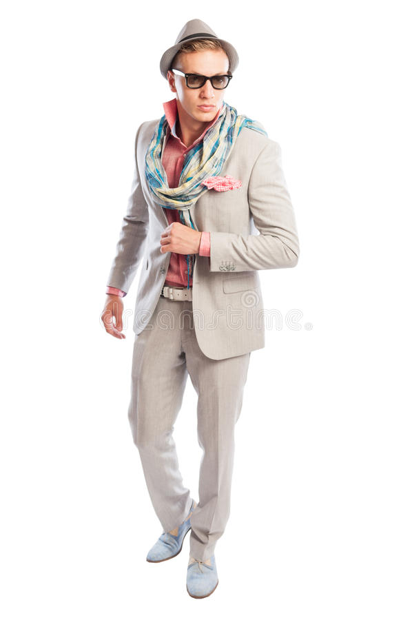 Elegant and fancy or funky fashion concept. With blond male model wearing light grey suit, scarf, sunglasses and hat stock photo