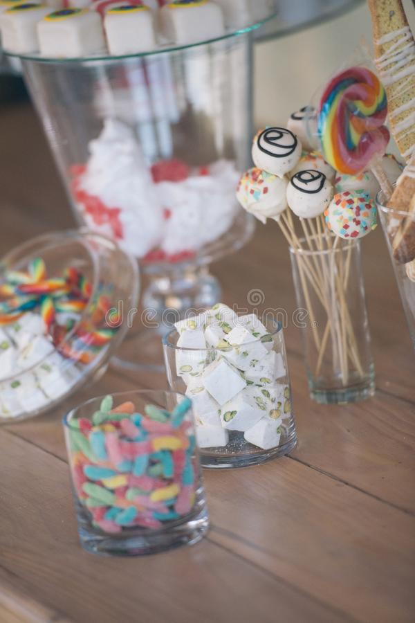 Elegant fancy modern vintage simple tasty sweet table at an upscale wedding stock photo