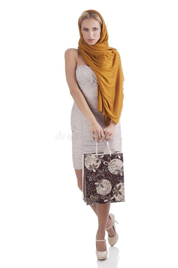 Elegant fashion girl holding shopping bag stock photo