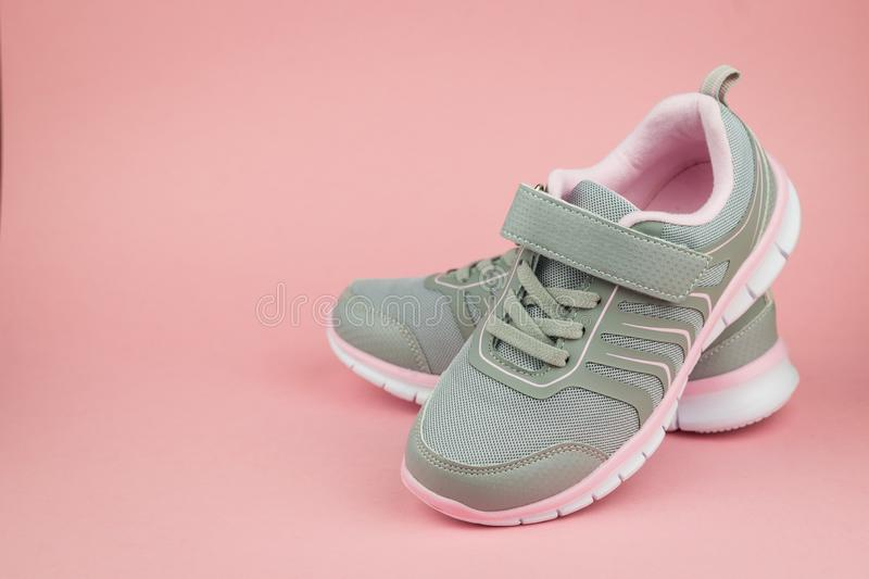 Elegant fashion gray sneakers on pink background. Color trend. Elegant fashion gray sneakers on pink background. Sports shoes. Color trend stock photos