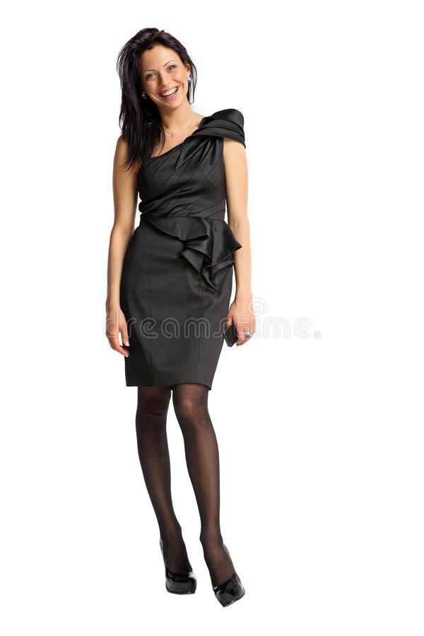 Elegant fashion model in black dress smiling royalty free stock photos