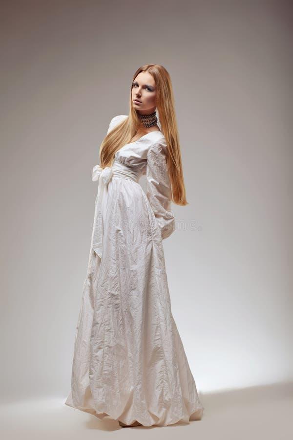 Elegant fashion woman in medieval era dress. royalty free stock image