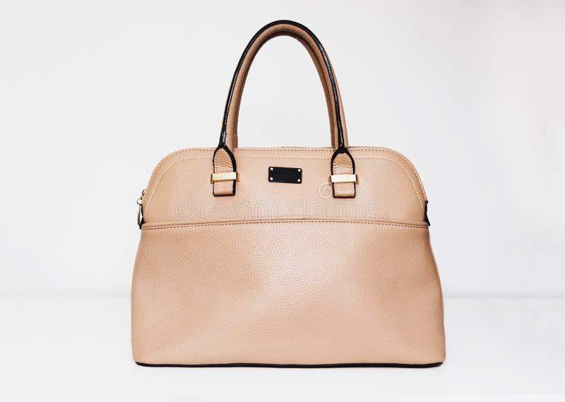 Elegant fashionable formal beige leather handbag for business woman on white background, trendy minimalistic luxury style stock photos