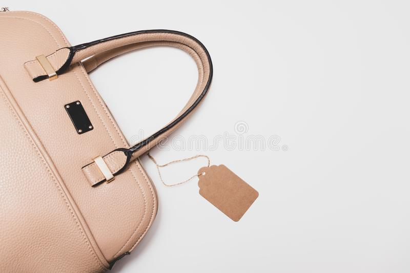 Elegant fashionable formal beige leather handbag for business woman on white background, trendy minimalistic luxury style with royalty free stock photo