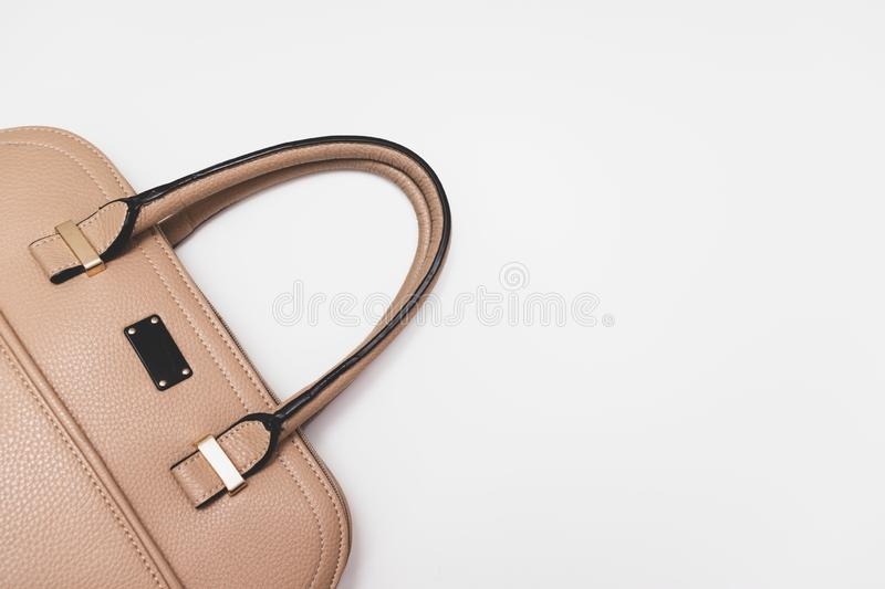Elegant fashionable formal beige leather handbag for business woman on white background, trendy minimalistic luxury style with royalty free stock images