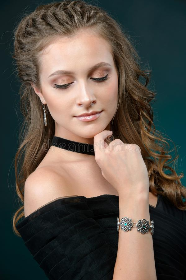 Elegant fashionable girl with fashionable jewelry necklace earrings and ring stock image