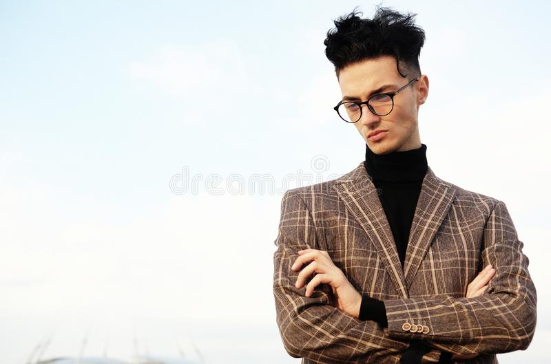 Elegant fashionable man in glasses royalty free stock photography