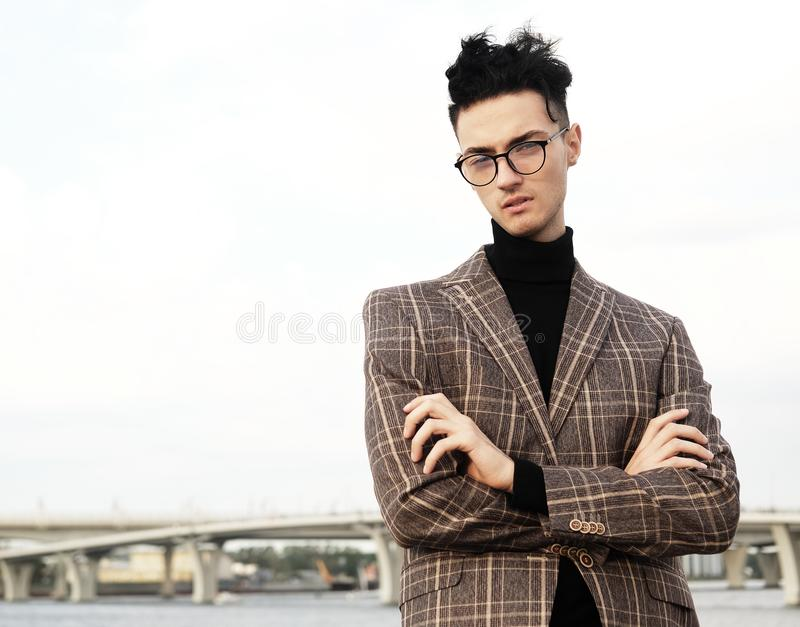 Elegant fashionable man in glasses stock image