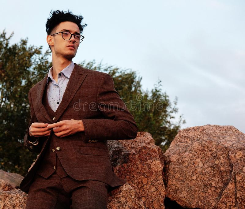 Elegant fashionable man in glasses stock images