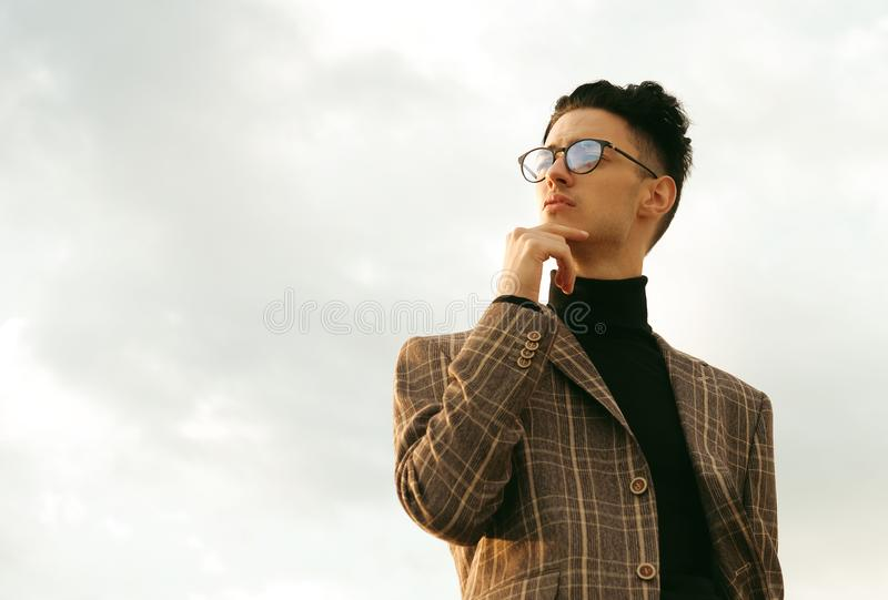 Elegant fashionable man in glasses stock photos