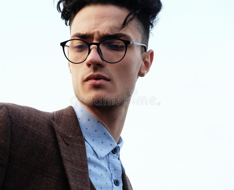 Elegant fashionable man in glasses royalty free stock image