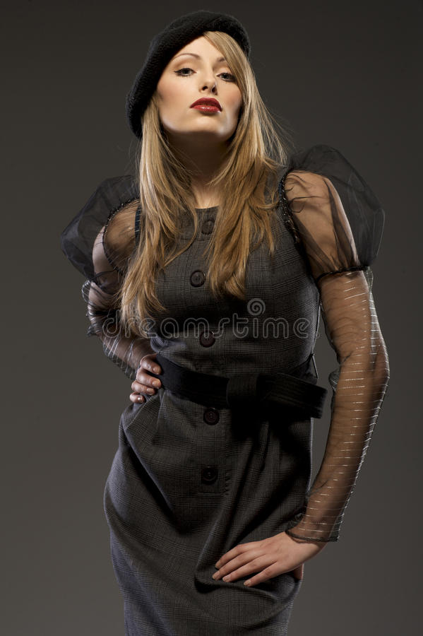 Elegant Fashionable Woman In A Hat Royalty Free Stock Image
