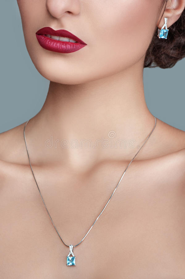 Elegant fashionable woman with jewelry. Beautiful woman with topaz pendant. Jewellery and accessories. stock photography