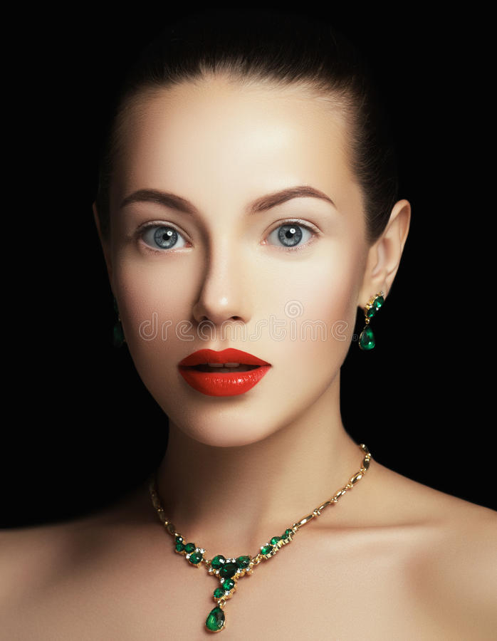 Elegant fashionable woman with jewelry. Fashion concept. Elegant fashionable girl with jewelry. Beautiful woman with emerald necklace. Young beauty model girl royalty free stock photos