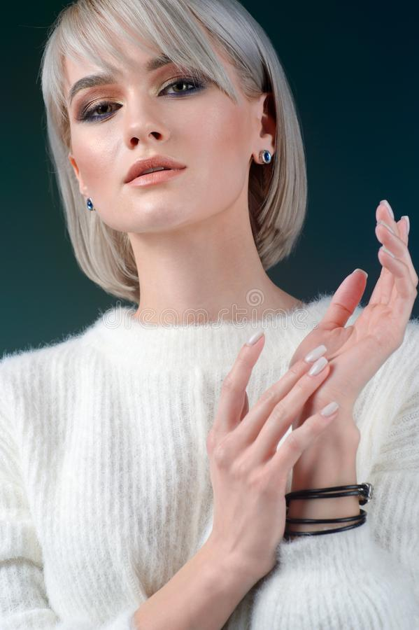 Elegant fashionable woman with silver jewelry stock photos