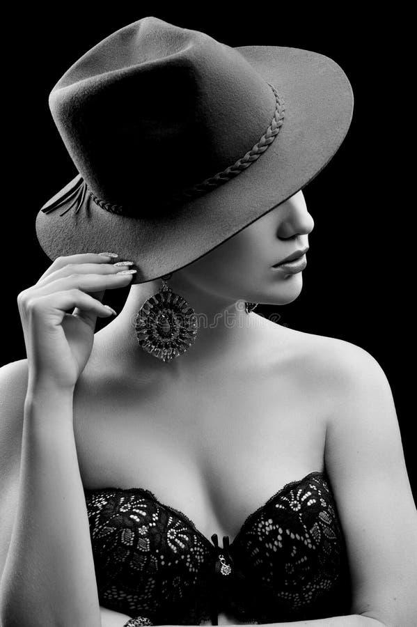 Elegant female model wearing a hat hiding her face stock image