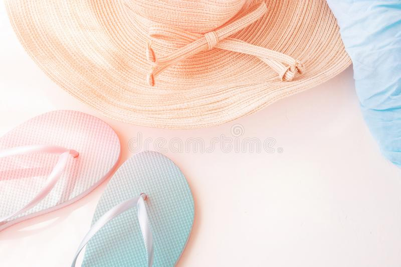 Elegant Female Straw Hat Blue Slippers Beach Wrap on White Background Golden Pink Flare Pastel Colors Summer Vacation stock photography