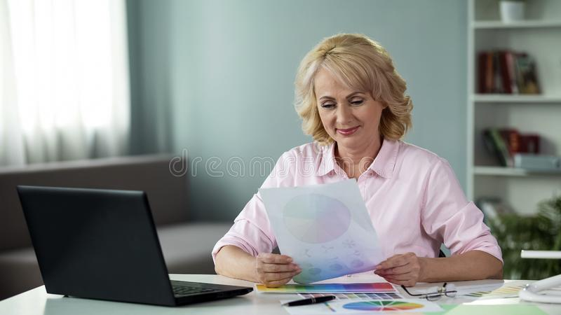 Elegant freelance worker looking at color scheme, preparing design project. Stock photo stock photos